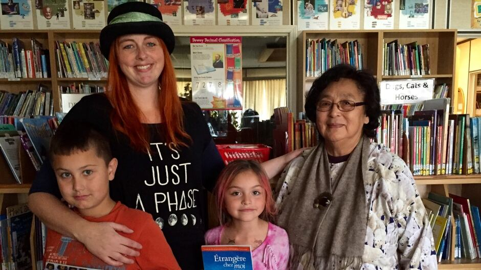 Book authors Christy Jordan-Fenton  and Margaret Pokiak-Fenton, with family in a B.C. school library before a presentation on residential schools.