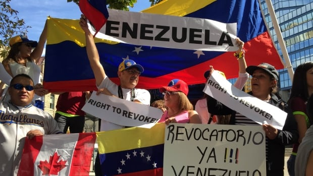 Protestors in Calgary want Venezuela President Maduro to be recalled and new elections held.