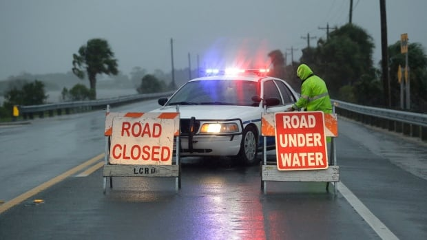 Police block the road entering Cedar Key, Fla., as Hurricane Hermine neared the Florida coast Thursday night.