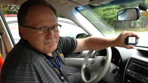 Gary Hunt, safety co-ordinator for the Nova Scotia Trucking Safety Association, holds DriveCare, a made-in-Nova Scotia device that silences a cellphone while a person is driving.