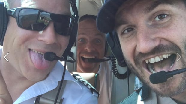 "Singer Bob Bissonnette, right, posted this image on Instagram and Facebook on Saturday with the French-language caption: 'Headed to Caraquet, N.B. Quiet in the helicopter!!"" Bissonnette and pilot  Frederick Décoste were killed in a helicopter crash on Sunday."