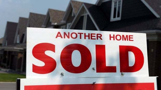 A sold sign in front of a home in Ottawa in July 2015. That year, the average price for a home was about $368,000. In 2017, the estimated price will be about $378,000.