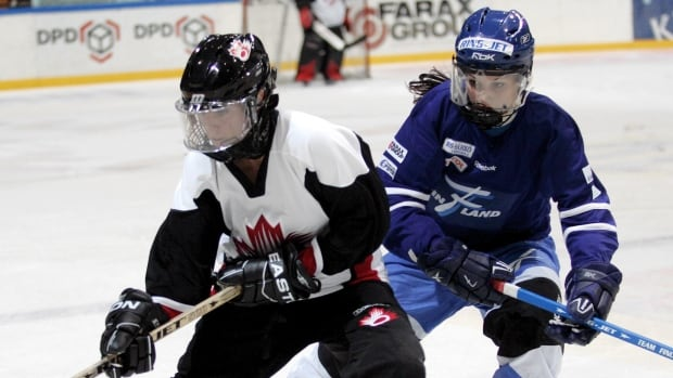 Canada's Dallas Robbins, left, battles Finland's Susanna Tapani during the 2010 World Ringette Championship in Tampere, Finland.