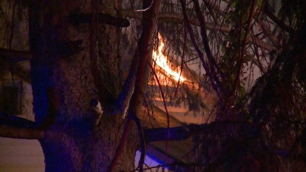 SURREY HOUSE FIRE REIGNITES