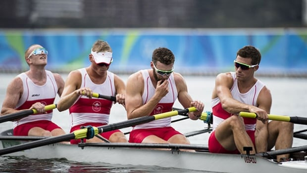 The Canadian men's coxless four team of, right to left, Kai Langerfeld, Conlin McCabe, Tim Schrijver and Will Crothers reacts after finishing sixth at the Rio Olympics, where Canada came away with just one medal.