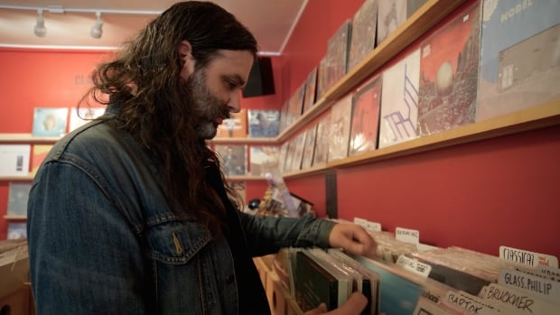 Vinyl (and CD) collector J.P. Fulford picks through some records at Red Cat's Main Street shop.
