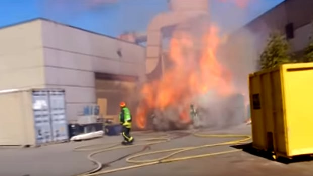 Crews in Abbotsford, B.C. fight a fire in an industrial hopper on September 12, 2016.