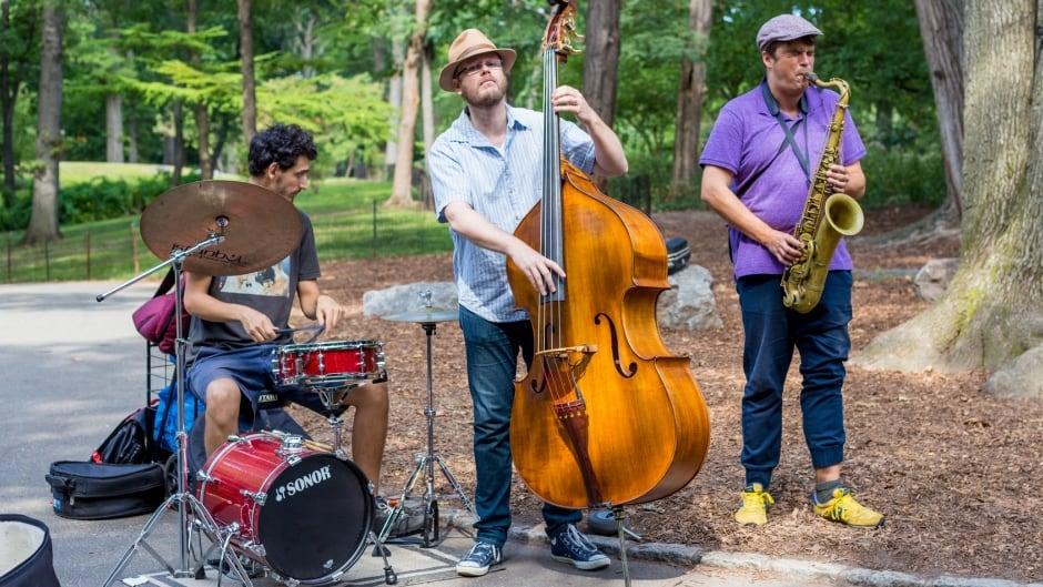 New York, USA - September 10, 2014: Jazz trio perform in Central Park, New York.