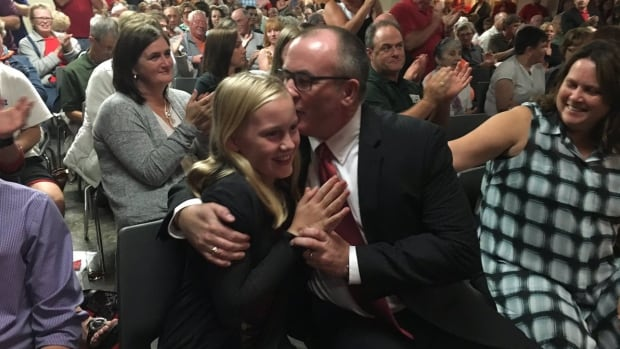 Chris Palmer celebrates his victory for the Liberal nomination in the Summerside-Wilmot riding, with his daughter Sydney to his left, and wife Kyla Palmer to his right.
