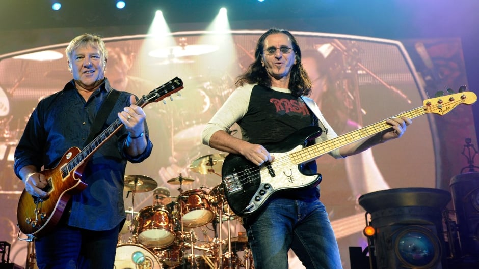 LAS VEGAS - AUGUST 14:  (L-R) Rush guitarist Alex Lifeson, drummer Neil Peart and singer/bassist Geddy Lee perform at the MGM Grand Garden Arena during a stop of the band's Time Machine Tour August 14, 2010 in Las Vegas, Nevada.  (Photo by Ethan Miller/Getty Images)