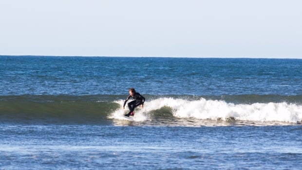 Ryan Mansfield is still surfing in his lightest neoprene wetsuit this late in the season.