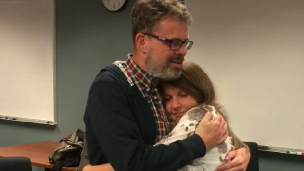 Kevin and Julia Garratt shown here reuniting at Vancouver airport, say crafting deeper ties with China is a worthwhile effort providing Canada knows what its getting into.