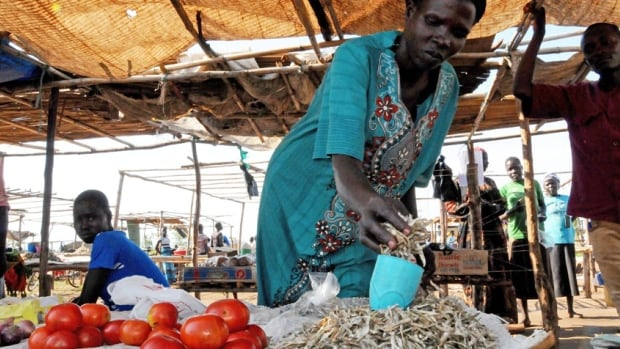 Mary Opia Phillip sold her clothes and some bedsheets to buy tomatoes, fish and onions she could sell in the market, with hopes of earning enough money to feed her children.