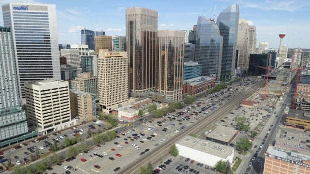 The CP Rail lines cuts through the heart of Calgary, flanked largely by surface parking lots.