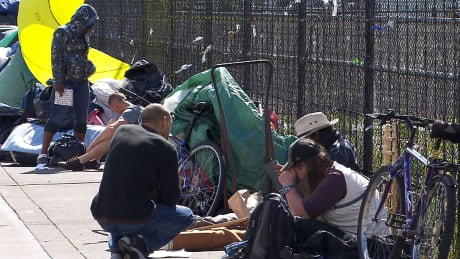 Lift ban on tarps on Surrey strip during heavy rain, says homeless advocate