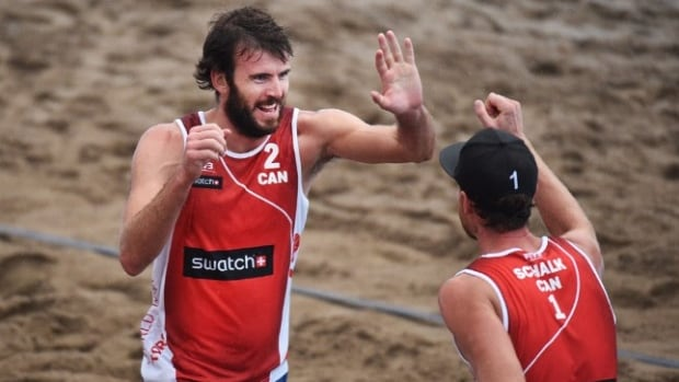 Canada's Chaim Schalk and Ben Saxton advanced to the semifinals of the beach volleyball World Tour Finals in Toronto on Saturday. They will play in the final on Sunday.