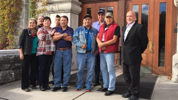 Rick Desautel, centre left with arms crossed, stands in front of the Nelson courthouse on Monday morning with members of the Colville Confederated Tribes, awaiting the start of a hearing into the existence of the Sinixt First Nation.