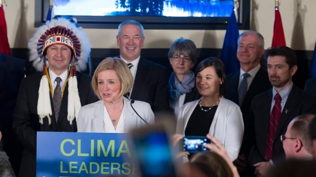 Ed Whittingham (right) of the Pembina Institute jokes about how he looks dazed in this photo from Alberta's climate plan announcement last November. He calls it an ambitious plan and a challenge to implement.