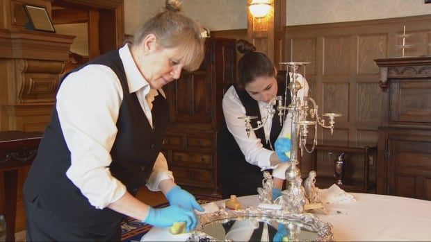 Karen Dale (left) and Odessa Corlette (right) shine silverware at Government House before the Duke and Duchess of Cambridge arrive.