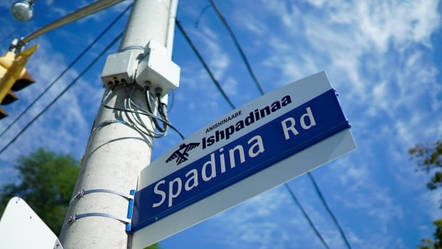 Official signs are cropping up across the city, with four of Toronto's major streets now bearing signs with their Anishinaabe names. Spadina, or Ishpadinaa, is one of them.