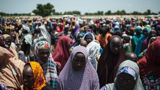 Women and children line up to enter one of the UNICEF nutrition clinics at a makeshift camp on the outskirts of Maiduguri, Borno state, Nigeria, on Sept 15. Aid agencies have long warned about a humanitarian crisis in northeast Nigeria.