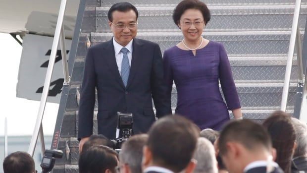 Chinese Premier Li Keqiang and his wife Cheng Hong arrive at the Ottawa airport to begin a four-day Canadian visit on Wednesday, September 21, 2016.
