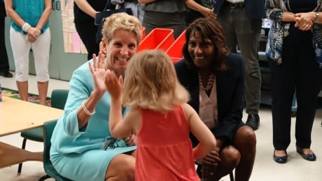 Kathleen Wynne and Indira Naidoo-Harris at Ottawa's Horizon-Jeunesse French Catholic school