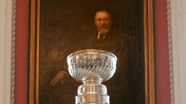 The Stanley Cup sits in front of a portrait of Frederick Stanley Lord Stanly of Preston at Rideau Hall in Ottawa.