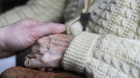 Alzheimer's holding hands