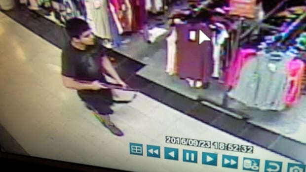This frame from surveillance video provided by the Washington State Patrol shows the suspect in a shooting rampage that killed five people at the Cascade Mall in Burlington, Wash.
