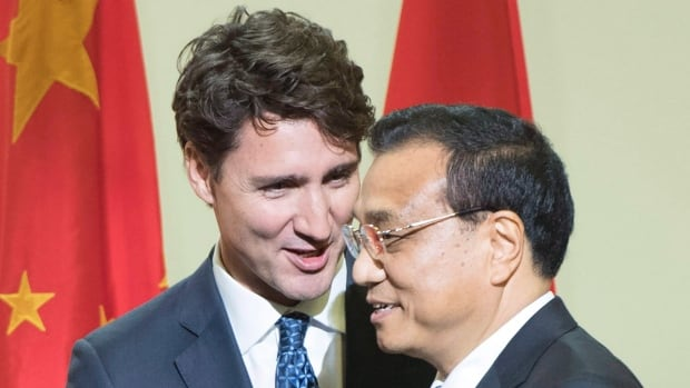Prime Minister Justin Trudeau, left, introduces Chinese Premier Li Keqiang at a business luncheon in Montreal last year. Canada and China have pledged not to engage in cyber espionage against each other's commercial interests, according to the PMO.