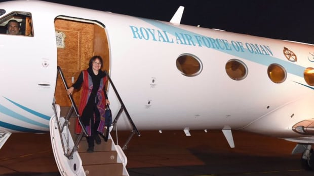 Canadian university professor Homa Hoodfar, seen here in a picture posted to Twitter by Oman News, was released from Iran Monday and is currently in Oman.