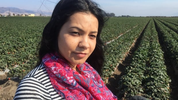 Adilene Constante, the daughter of crop pickers, is among the first graduates of a program that helps a new generation embrace technology to escape a life of back-breaking labour in the fields.