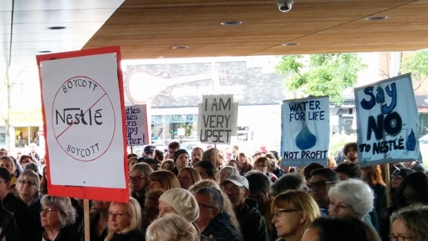 Protesters gather outside Guelph City Hall ahead of a Monday night meeting where delegates where not allowed to address city politicians about Nestle's watertaking permit in nearby Aberfoyle. Opponents will have to wait until Nov. 7 to have their say.
