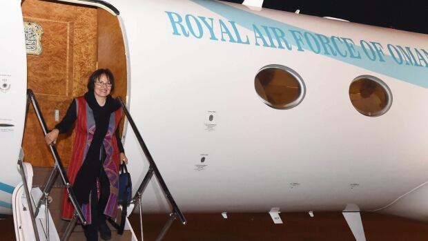 Iranian-Canadian professor Homa Hoodfar arrives in Muscat airport, Oman, after being released by Iranian authorities on Monday.