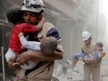 A grief-stricken Syrian man is comforted by people as rescuers pull the body of his daughter from the rubble of a building in the rebel-held neighbourhood of Al-Shaar, Aleppo, Sept. 27, 2016.