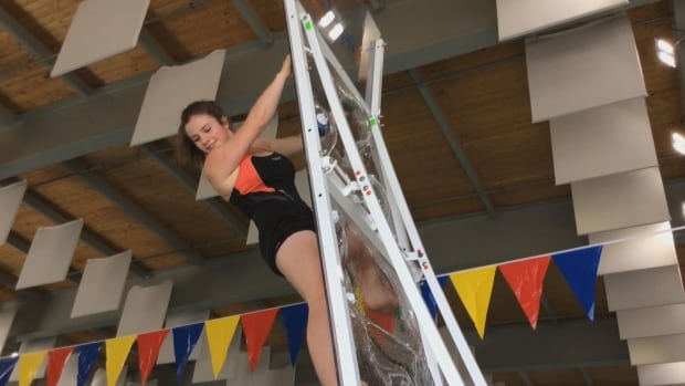 Lifeguard Jessica Lewis says it took a couple of tries to get the hang of the new aquatic climbing wall but this time, she made it to the top before taking the plunge.