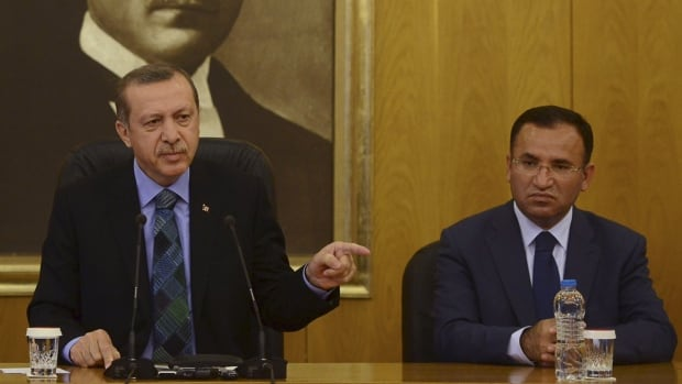 Turkey's Prime Minister Tayyip Erdogan, and Bekir Bozdag are seen in a file photo. Bozdag said a total of about 70,000 people have faced legal proceedings on suspicion of links with U.S.-based cleric Fethullah Gulen, whom the government says engineered July's failed coup.