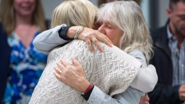 Kimberley Manning, left, and Margie Mendell, friends and colleagues of Canadian professor Homa Hoodfar, hug Monday in Montreal as they celebrate their friend's release from Tehran's notorious Evin prison.