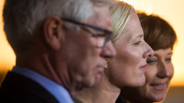 Federal Environment Minister Catherine McKenna, centre, is flanked by Natural Resources Minister Jim Carr and British Columbia Premier Christy Clark after the Liberal government announced approval of the Pacific NorthWest LNG project.