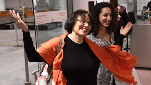 Iranian-Canadian professor Homa Hoodfar smiles as she arrives in Montreal on Thursday.