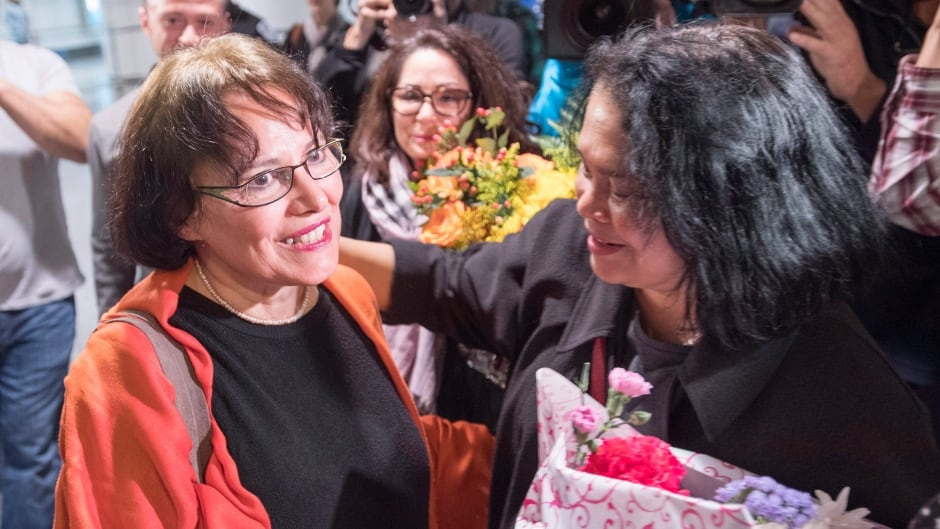 Homa Hoodfar is welcomed as she arrives at Trudeau Airport Thursday, September 29, 2016 in Montreal. Hoodfar, a Canadian-Iranian academic was held in Iran's Evin prison for more than 100 days.