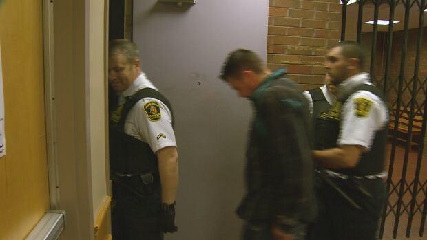 Vincent Leonard Jr. being led into St. John's provincial court in 2016.