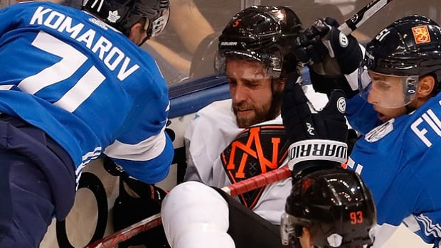 Initially, it was reported that Team North America defenceman Aaron Ekblad, middle, suffered a concussion after Finland's Leo Komarov hit him in a Sept. 18 game at the World Cup of Hockey in Toronto. On Thursday at Florida Panthers training camp, Ekblad said the diagnosis was a mild neck injury which he described as whiplash.