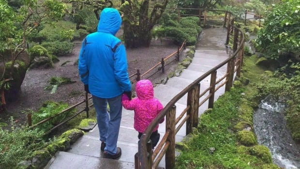 A two-year-old Métis toddler at the heart of a court fight between foster parents and the B.C. government walks with the foster father in Butchart Gardens,  January 2016.