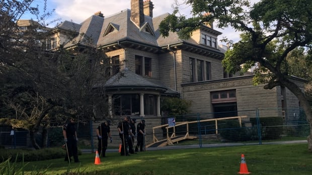 Police were present in large numbers at the Gabriola Mansion on Thursday after discovering a body there Wednesday night.