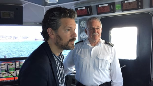 Mayor Dagur Eggertsson, of Reykjavik, Iceland, in Seabus wheel house as part of two-day tour of Metro Vancouver's transit system.