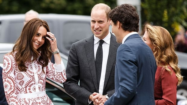 Andrew Chin's photo of (L-R) Catherine, Duchess of Cambridge, and Prince William, Duke of Cambridge's arrival at the Immigrant Services Society of B.C. on September 25, 2016 in Vancouver, B.C.