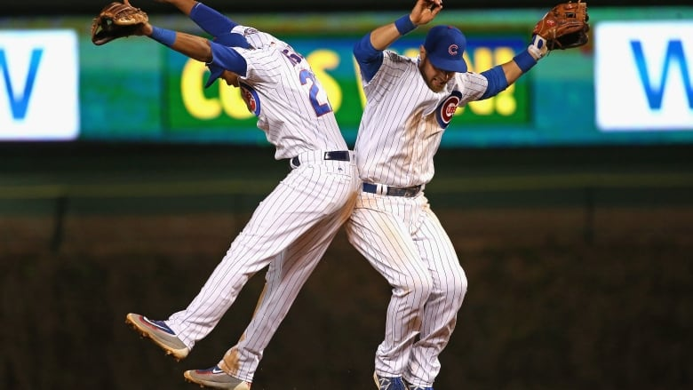 233261c48ab4f Addison Russell (L) and Ben Zobrist of the Chicago Cubs celebrate a win  over the Milwaukee Brewers at Wrigley Field. (Jonathan Daniel Getty Images)