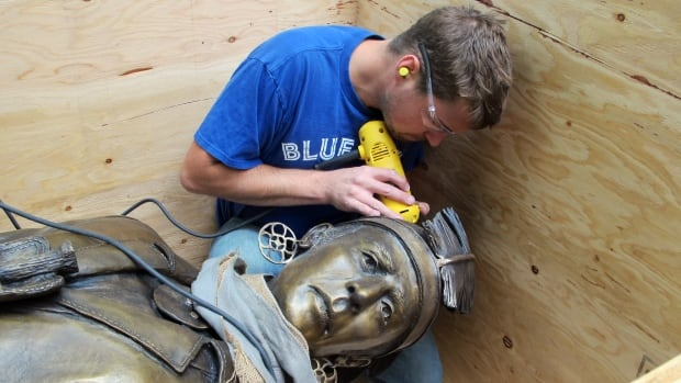 A worker polishes the two-metre, 340-kilogram brass statue of First Nations war captain John Brant, who played an important in defeating invading Americans in the War of 1812. John Brant is son of another Mohawk leader, Joseph Brant.